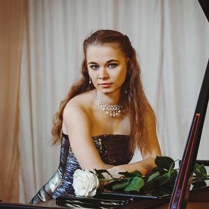 Анна Грот